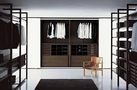 White Wardrobe Closet White Wall With Planted Wardrobe Closet Made Of Wooden In Dark