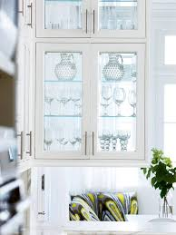 white kitchen cabinet with glass doors glass front cabinetry better homes gardens
