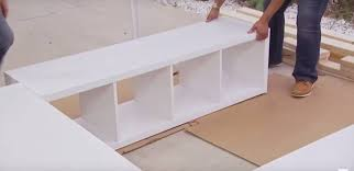 Build A Platform Bed With Storage Underneath by How To Add Extra Storage In Your Bedroom Tiphero