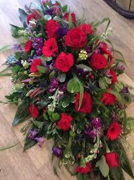 how to make a casket spray blues and purple casket spray buds the flower shop