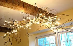 christmas sticks with lights sticks and christmas lights for rustic chandelier hmmm maybe in the