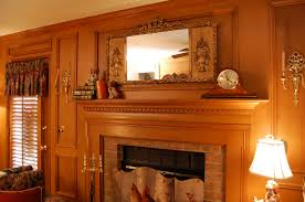 glancing framed mirror in small clock with mantel decor idea feat