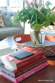stay at home ista stacking books on the coffee table
