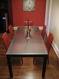 casual dining room with two type wall color and nice paintings