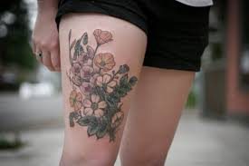 82 superb flower tattoos on thigh