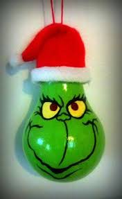 grinch ornament grinch painted on an light bulb