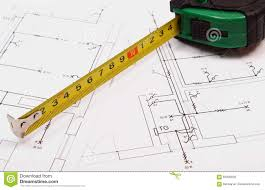 tape measure on electrical construction drawing of house stock