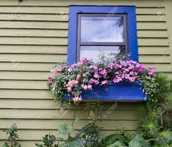 A Garden Of Flowers by A Window Box Full Of Flowers Above A Garden Stock Photo Picture