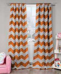 picture of heavy set women in a two piece bathing suit duck river textile orange fifika heavy blackout curtain panel set