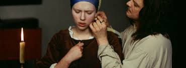 girl pearl earing how is sexual tension conveyed in girl with a pearl earring