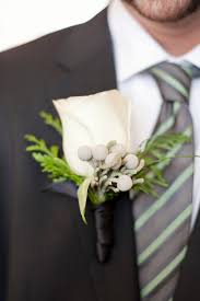 groom s boutonniere a rustic winter wedding in the mountains kate aspen