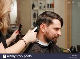 professional hairdresser doing haircut men u0027s hair cutting