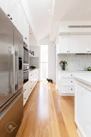oak kitchen cabinets with oak flooring oak flooring and white cabinetry detail in a new kitchen