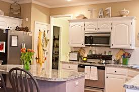 Space Above Kitchen Cabinets Ideas Space Above Kitchen Cabinets Called White Hood Stainless Steel