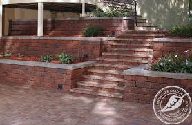 Retaining Wall Stairs Design Terraced Retaining Walls Along With Stairs Leading To A Patio