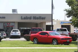 texas company buys laird noller car dealership in hutchinson