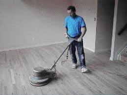 used floor sanding machines on floor throughout refinishing