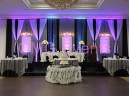 wedding backdrop setup black and white glam backdrop and table set up two tome