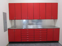 small garage spaces with metal cabinets painted with red color and