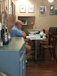 man reading morning paper 24 south coffee house wilmington n c