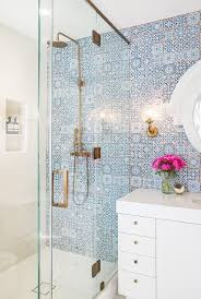 showstopping bathroom tiles brass faucet white quartz and moroccan