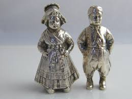 novelty salt and pepper shakers a pair of silver novelty salt pepper shakers in form of a girl