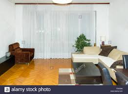 Corner Sofa Living Room Modern Clean Living Room Interior With Cabinet And Tv Rack Stock