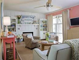 beach house style with coral and white walls and slipcovered arm