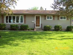 beige house with black shutters jewsonenterprises com