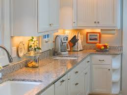 glass countertops cost to replace kitchen cabinets lighting