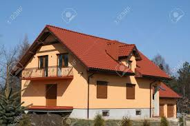 new single family house with red slate roof orange walls stock