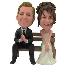 customized cake toppers custom personalized wedding cake topper of a on a bench by