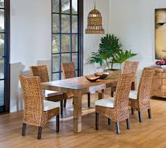 beautiful rattan dining room chairs set and wood table in a dining