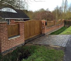 Garden Boundary Ideas by Walled And Gated Driveway Lush Garden Design