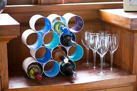 diy wine bottle rack made from coffee cans home design garden
