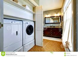 light grey hallway with built in washer and dryer stock photo