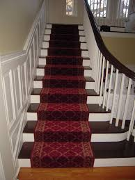 decorating blue stair treads carpet with wood stair railing and