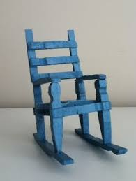hand made antique miniature rocking chair made of clothes pins