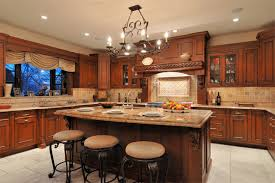 old world wood mode kitchen with large cooking hearth by mario