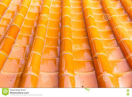 Yellow Orange Glazed Terracotta Roof Tiles Of A Chinese Temple