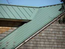 corrugated metal vs standing seam metal roof side by side