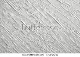 Grey Textured Paint - texture white paint on gray background stock photo 575864206