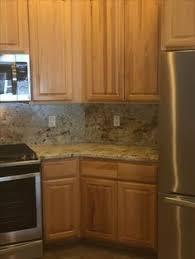 colonial cream granite island counter with ogee edge profile