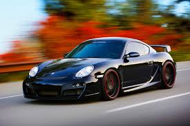 porsche cayman 3 4 2008 porsche cayman s techart black 3 4 front view driving by