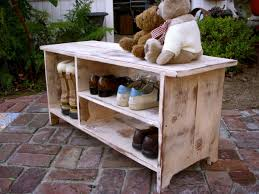 simple patio with wood shoe shelf storage bench dolls bears on