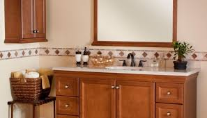 sink tuscan bathroom with wooden vanities with granite