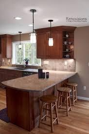 limestone countertops dark cherry kitchen cabinets lighting