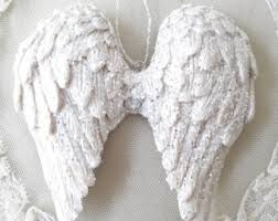 small silver tipped white shabby wings ornaments these are