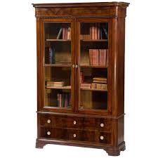 furniture brown tall wooden bookcase with sliding glass doors on
