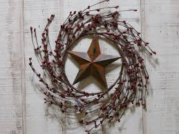 primitive country style burgundy berry wreath with rusty star
